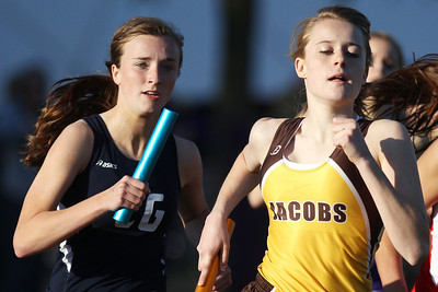 Mike Greene - mgreene@shawmedia.com Cary-Grove's Annie McGarrigle (left) runs behind Jacobs' Aleta Wurfel while competing in the 4x800 meter relay at the IHSA Girls Sectional Championship Meet Thursday, May 10, 2012 in Rockton. Cary-Grove won the meet overall and will have entries from all four relays and four individuals going to state.