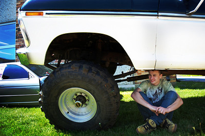 Daniel J. Murphy - dmurphy@shawmedia.com  John Incaudo, 17, sits under his 1976 Ford F-250 pickup truck Friday May 11, 2012 at Cary-Grove High School in Cary. Cary-Grove High School students hosted a car show featuring cars owned by students, parents, and faculty members.