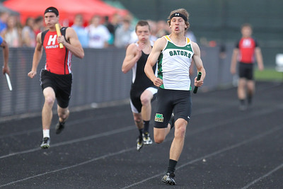 Mike Greene - mgreene@shawmedia.com Crystal Lake South's Zane Boettcher runs anchor for in the 4x100 meter relay at the FVC Boys Track Meet Friday, May 11, 2012 in Woodstock. Crystal Lake South won the event and broke the conference record in the process.