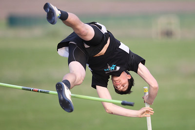 Mike Greene - mgreene@shawmedia.com Woodstock North's Jon Walsh watches the fall while attempting a jump at 15''03'' in the pole vault event at the FVC Boys Track Meet Friday, May 11, 2012 in Woodstock. Walsh took second place in the event.