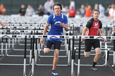 Mike Greene - mgreene@shawmedia.com Woodstock's Tyler Parsons eyes the last hurdle while competing in the 110 meter high hurdles finals at the FVC Boys Track Meet Friday, May 11, 2012 in Woodstock. Parsons took first place in the event.