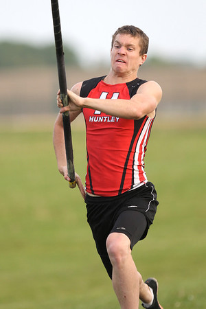 Mike Greene - mgreene@shawmedia.com Huntley's Ryan Sheehan takes his approach while competing in the pole vault event at the FVC Boys Track Meet Friday, May 11, 2012 in Woodstock. Sheehan tied for third place in the event.