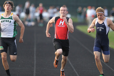 Mike Greene - mgreene@shawmedia.com Huntley's James Davis (center) and Cary-Grove's Tommy Rohn (right) try to catch up to Crystal Lake South's Zane Boettcher (left) while competing in the100 meter dash finals at the FVC Boys Track Meet Friday, May 11, 2012 in Woodstock. Boettcher took first place in the event.