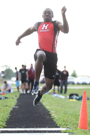 Mike Greene - mgreene@shawmedia.com Huntley's C J Ayemoba takes off while competing in the long jump event at the FVC Boys Track Meet Friday, May 11, 2012 in Woodstock. Ayemoba won the event.