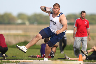 Mike Greene - mgreene@shawmedia.com Cary-Grove's Josh Freeman spins before throwing in the shot put at the FVC Boys Track Meet Friday, May 11, 2012 in Woodstock. Freeman won the event and set a conference record.