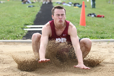 Mike Greene - mgreene@shawmedia.com Prairie Ridge's Nick Nissen lands while competing in the long jump at the FVC Boys Track Meet Friday, May 11, 2012 in Woodstock.