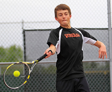 Brett Moist for The Northwest Herald Crystal Lake Central's Jake Lenhard returns a serve against Grayslake Central during his second set of his doubles Final round Match at Crystal Lake South High School on Saturday.