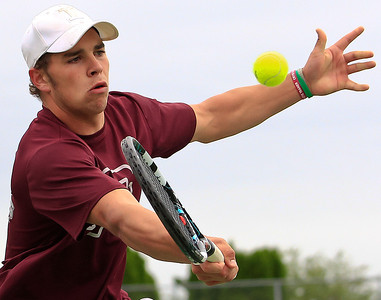 Brett Moist for The Northwest Herald Prairie Ridge's Connor Greenwald returns a volley from Crystal Lake Central's Josh Pudlo during the second set of their Singles Final Matchup at Crystal Lake South High School on Saturday.