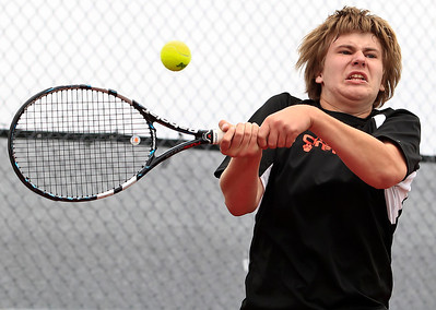Brett Moist for The Northwest Herald Crystal Lake Central Freshman Josh Pudlo returns a serve from Prairie Ridge's Connor Greenwald during the first set of their Singles Final Matchup at Crystal Lake South High School on Saturday.