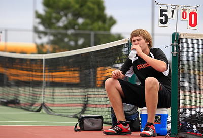 Brett Moist for The Northwest Herald Crystal Lake Central Freshman Josh Pudlo takes a break in between sets of his Singles Final Matchup against Prairie Ridge's Connor Greenwald at Crystal Lake South High School on Saturday.