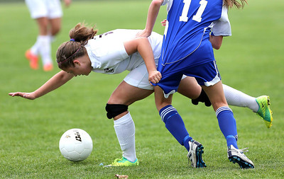 Joe Shuman/For the Northwest Herald  North Chicago-5/12/12, Sat./North Chicago High School #12 Kendall Winkler, of Richmond-Burton, and #11 Sarah Weaver, of Johnsburg get tangled up durng game Saturday.