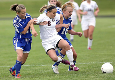 North Chicago-5/12/12, Sat./North Chicago High School #8 Amanda Hoglund of Richmond-Burton runs into traffic vs. #26 Kortnee Hass, and #16 Anna Fox, of Johnsburg during regional game play Saturday at North Chicago High School. Joe Shuman/For Northwest Herald