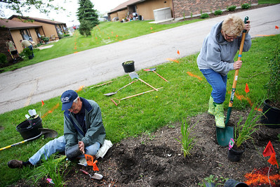 Daniel J. Murphy - dmurphy@shawmedia.com  John Thunholn of and Sandy Scalise both of Huntley plant native grasses Saturday May 12, 2012 at the Green Trees Apartment Complex in Huntley. The McHenry County Housing Authority and Pam Fender are refurbishing the landscaping on the Complex, which houses low-income and developmentally-disabled seniors.