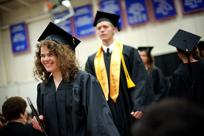 Daniel J. Murphy - dmurphy@shawmedia.com  Rebecca Burns, 20, of Crystal Lake leaves the Spring Commencement ceremony with an Associates in Science degree Saturday May 12, 2012 at McHenry County College in Crystal Lake.