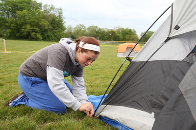 Mike Greene - mgreene@shawmedia.com Taylor Sullivan, 16 of Crystal Lake, works setting up a tent for herself and other members of the Willow Creek Student Impact youth group at SleepOut for Shelter Saturday, May 12, 2012 at Immanuel Lutheran School and Church in Crystal Lake. Event participants spent the night outside in tents, boxes or cars to raise awareness and money for McHenry County PADS.