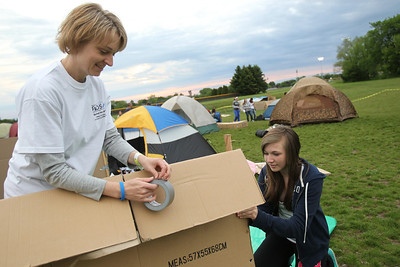 Mike Greene - mgreene@shawmedia.com Crystal Lake residents Laurie Sabol and Marissa Koch, 13, build a shelter Saturday, May 12, 2012 at Immanuel Lutheran School and Church in Crystal Lake. Sabol and Koch participated in SleepOut for Shelter, a countywide, educational experience and fundraiser, to help end homelessness in McHenry County.