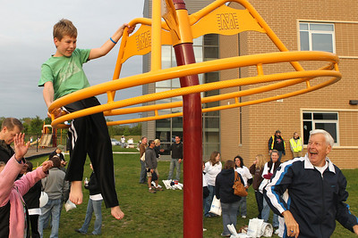 Mike Greene - mgreene@shawmedia.com Andrew Austin, 12 of Crystal Lake, rides park equipment spun by his granfather, Orlo Austin, at SleepOut for Shelter Saturday, May 12, 2012 at Immanuel Lutheran School and Church in Crystal Lake. Event participants spent the night outside in tents, boxes or cars to raise awareness and money for McHenry County PADS.