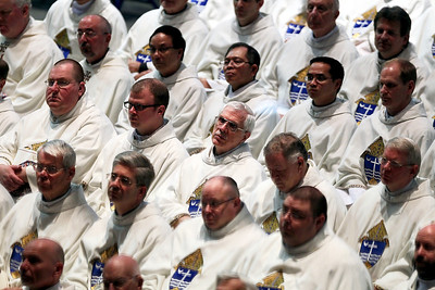 Sarah Nader - snader@shawmedia.com Priests, deacons and seminarians sit down during the ordination of David Malloy as the ninth bishop of Rockford at the BMO Harris Bank Center in Rockford on May 14, 2012.