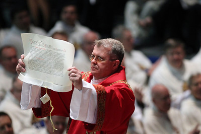 Sarah Nader - snader@shawmedia.com Kevin Prunty, chaplain to the Apostolic Nuncio to the United States Archbishop Carlo Maria Vigano, shows the Apostolic Letter to the crowd during the ordination of David Malloy as the ninth bishop of Rockford at the BMO Harris Bank Center in Rockford on Monday, May 14, 2012.