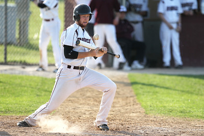 Mike Greene - mgreene@shawmedia.com Prairie Ridge's Lucas Keller attempts to avoid the ball after attempting a bunt during a game against Cary-Grove Monday, May 14, 2012 in Crystal Lake. The ball was ruled foul. Prairie Ridge won the game 2-0.