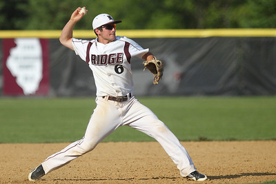 Mike Greene - mgreene@shawmedia.com Prairie Ridge's Kyle Hodorowicz loads a throw to first base after fielding a ground ball during a game against Cary-Grove Monday, May 14, 2012 in Crystal Lake. Prairie Ridge won the game 2-0.