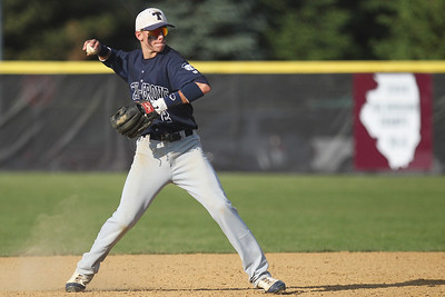 Mike Greene - mgreene@shawmedia.com Cary-Grove's Matt Byrne loads before throwing to first base after fielding a ground ball during a game against Prairie Ridge Monday, May 14, 2012 in Crystal Lake. Prairie Ridge won the game 2-0.