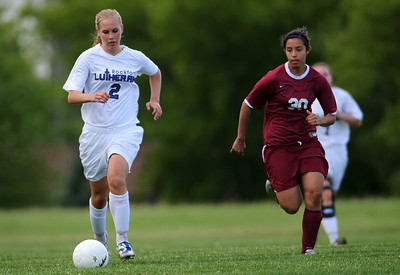 Daniel J. Murphy - dmurphy@shawmedia.com  Rockford Lutheran midfielder (left) and Marengo's Becca Vazquez (right) chase down the ball in the first half Tuesday May 15, 2012 at Harvard Junior High School. Marengo fell to Rockford Lutheran 0-7 after a lightning delay.