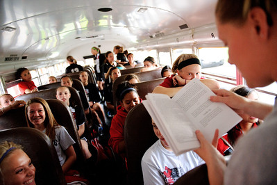 Daniel J. Murphy - dmurphy@shawmedia.com  Assistant coach Cara Arnold reads to the Stillman Valley girls soccer team Tuesday May 15, 2012 at Harvard Junior High School during a lightning delay of the Class 1A Harvard Sectional semifinal.