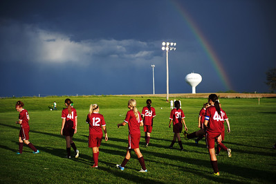 Daniel J. Murphy - dmurphy@shawmedia.com  The Marengo girls soccer team warms up after a lightning delay Tuesday May 15, 2012 at Harvard Junior High School. Marengo fell to Rockford Lutheran 0-7 after a lightning delay.