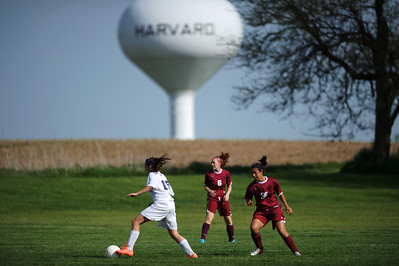 Daniel J. Murphy - dmurphy@shawmedia.com  Rockford Lutheran forward Rebecca Sparkman moves the ball past Marengo's Holly Stout (center) and Becca Vazquez (right) in the first half Tuesday May 15, 2012 at Harvard Junior High School. Marengo fell to Rockford Lutheran 0-7 after a lightning delay.
