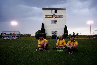 Daniel J. Murphy - dmurphy@shawmedia.com  ISHA Officials from left: Ray Nelson, Dave Rubini, and Gene Mroz rest in the grass during a lightning delay Tuesday May 15, 2012 at Harvard Junior High School. Marengo fell to Rockford Lutheran 0-7 after a lightning delay.