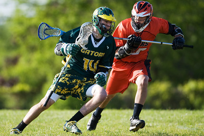 Daniel J. Murphy - dmurphy@shawmedia.com  Crystal Lake South's Tyler Mortensen zips past Crystal Lake Central defender Alex Amann in the second quarter Wednesday May 16, 2012 at Northwest United Soccer Club Field in Prairie Grove. Crystal Lake Central defeated Crystal Lake South 11-7.