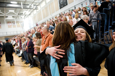 Daniel J. Murphy - dmurphy@shawmedia.com  McHenry East High School Dean of Students Jennifer Lawrence gives senior Hope Schmidt (right) a hug before taking a seat during the commencement ceremony Wednesday May 16, 2012 at McHenry East High School.