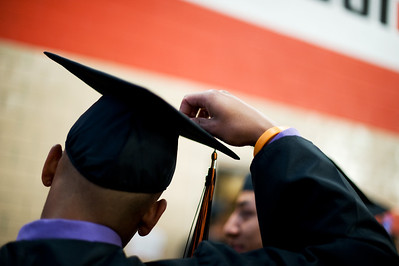 Daniel J. Murphy - dmurphy@shawmedia.com  Senior Brian Frapolly, 17, adjusts his cap before the 92nd annual commencement ceremony Wednesday May 16, 2012 at McHenry East High School.