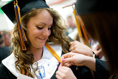 Daniel J. Murphy - dmurphy@shawmedia.com  Sarah Wandall, 17, (right) pins a purple ribbon to Cortney Kincaid's, 18, (left) gown before graduation Wednesday May 16, 2012 at McHenry East High School. The ribbons were worn in honor of former classmate Alex Baer, 17,  who died in a tragic skateboarding accident back in July 2010.
