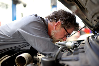 Daniel J. Murphy - dmurphy@shawmedia.com  Mechanic Clete Barkler replaces the fuel injectors on a Ford F-350 pickup truck Thursday May 17, 2012 at Harvard Ford in Harvard. Harvard Ford recently expanded its service department, which now includes drive-through lane for customers.