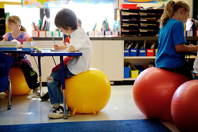 Daniel J. Murphy - dmurphy@shawmedia.com  First grade student Jacob Young, 6, (center) sits on a therapy ball Thursday May 17, 2012 at Harrison Elementary School in Wonder Lake. The school has been working with the first grade class on a pilot project giving students the option to use therapy balls as chairs.