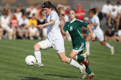 Mike Greene - mgreene@shawmedia.com Jacobs' Lauren Grady (left) controls the ball in the air on offense as Crystal Lake South's Elizabeth Massat defends during the Class 3A Jacobs Regional Final Friday, May 18, 2012 in Algonquin. Jacobs won the game 4-0 to take home the regional title.