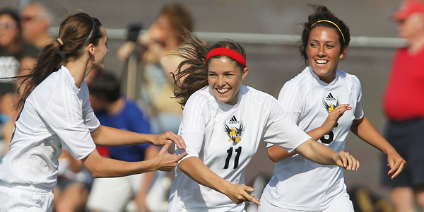 Mike Greene - mgreene@shawmedia.com Jacobs' Jessica Tennant (left), Margaret Rivera and Payton Berg celebrate after Rivera scored a goal during their Class 3A Jacobs Regional Final game against Crystal Lake South Friday, May 18, 2012 in Algonquin. Jacobs won the game 4-0 to take home the regional title.