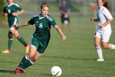 Mike Greene - mgreene@shawmedia.com Crystal Lake South's Elizabeth Massat winds to kick the ball during a Class 3A Jacobs Regional Final game against Jacobs Friday, May 18, 2012 in Algonquin. Jacobs won the game 4-0 to take home the regional title.