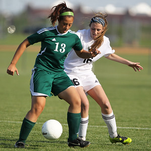 Mike Greene - mgreene@shawmedia.com Crystal Lake South's Cella Albuqerque (left) jostles for control of the ball against Jacobs' Danielle Blanchard during the Class 3A Jacobs Regional Final Friday, May 18, 2012 in Algonquin. Jacobs won the game 4-0 to take home the regional title.