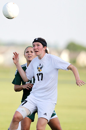 Mike Greene - mgreene@shawmedia.com Jacobs' Lauren Grady watches a ball drop as Crystal Lake South's Ashley Tyllia defends during a Class 3A Jacobs Regional Final game Friday, May 18, 2012 in Algonquin. Jacobs won the game 4-0 to take home the regional title.