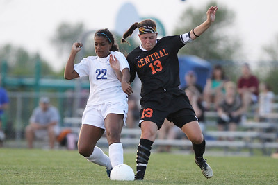 Mike Greene - mgreene@shawmedia.com Burlington Central's Leci Kern (left) and Crystal Lake Central's Madie Edwards vie for posession of the ball during the Class 2A Regional Finals Saturday, May 19, 2012. Edwards had two goals for the Tigers but Burlington Central won the game 3-2 in triple overtime.