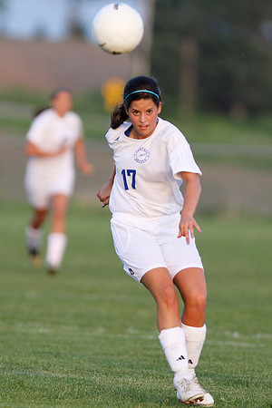 Mike Greene - mgreene@shawmedia.com Burlington Central's Jessica Martinez watches the flight of her kick during the Class 2A Regional Finals agaimst Crystal Lake Central Saturday, May 19, 2012. Burlington Central won the game 3-2 in triple overtime.