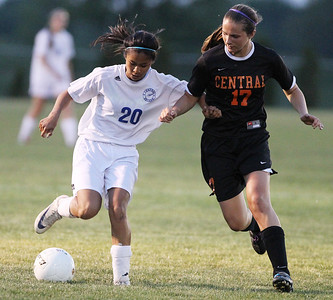 Mike Greene - mgreene@shawmedia.com Burlington Central's Camille Dela Cruz (left) and Crystal Lake Central's Alaina Passavant vie for posession of the ball during the Class 2A Regional Finals Saturday, May 19, 2012. Burlington Central won the game 3-2 in triple overtime.
