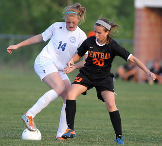 Mike Greene - mgreene@shawmedia.com Burlington Central's Rachel Griffin (left) and Crystal Lake Central's Kyra Savage vie for posession of the ball during the Class 2A Regional Finals Saturday, May 19, 2012. Burlington Central won the game 3-2 in triple overtime.