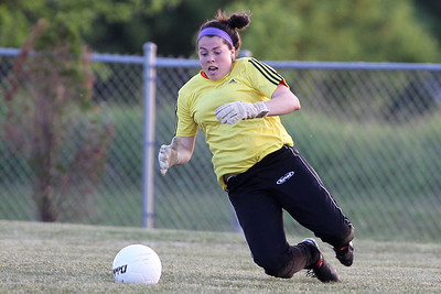 Mike Greene - mgreene@shawmedia.com Crystal Lake Central goalkeeper Caitlyn Dayton drops to cover a shot on goal during the Class 2A Regional Finals against Burlington Central Saturday, May 19, 2012. Burlington Central won the game 3-2 in triple overtime.