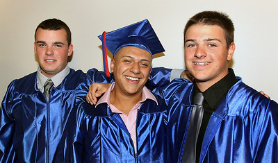 Jeff Krage – For the Northwest Herald Dundee-Crown graduate's (left to right) Brandon Henneman, Erik Garcia and Nick Hathon pose for a picture before the start of Saturday's graduation ceremonies at the Sears Centre. Hoffman Estates 5/19/12