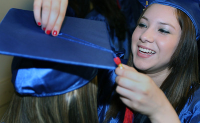 Jeff Krage – For the Northwest Herald Dundee-Crown graduate Wendy Garcia adjusts the cap of a fellow graduate before the start of Saturday's graduation ceremonies at the Sears Centre. Hoffman Estates 5/19/12