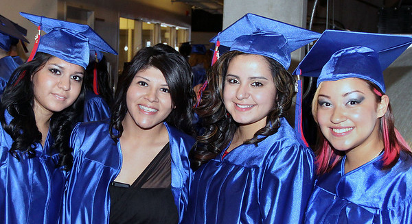 Jeff Krage – For the Northwest Herald Dundee-Crown graduate's (left to right) Maria Hernandez, Lilia Ruiz, Yoana Rodriguez and Daniela Rodriguez pose for a picture before the start of Saturday's graduation ceremonies at the Sears Centre. Hoffman Estates 5/19/12